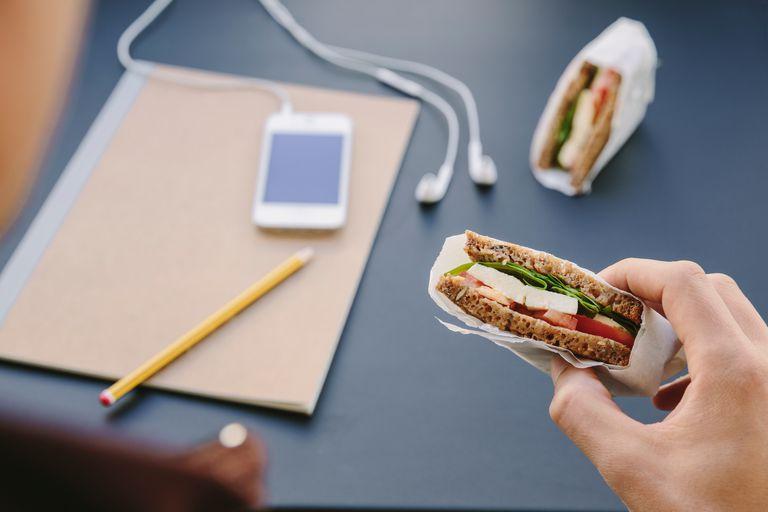 Man holding small sandwich