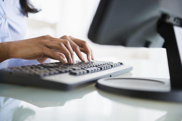 woman typing at computer