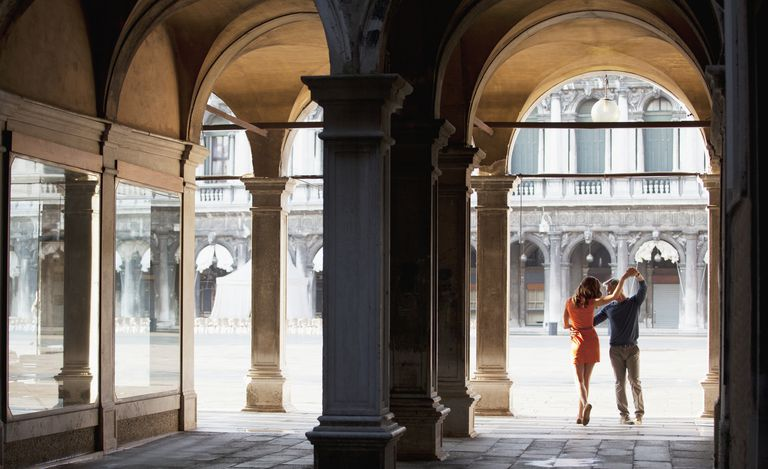 man and woman in archway in Venice