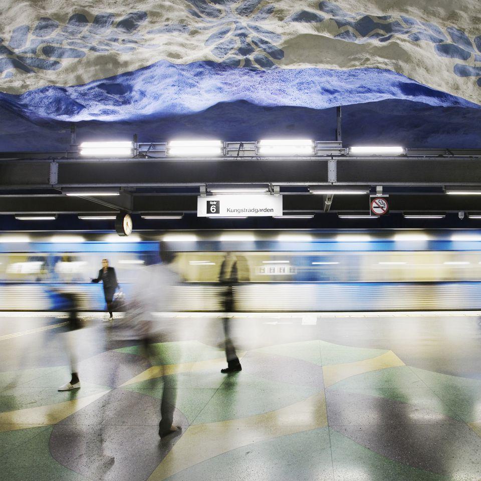 Passenger walking at a subway station, Stockholm, Sweden