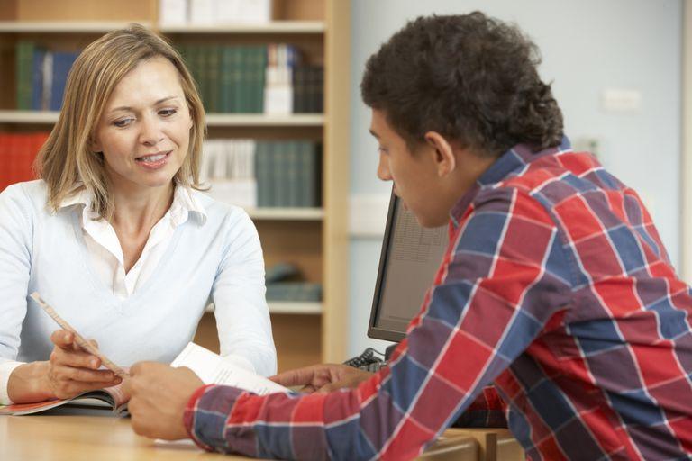 boy talking with teacher