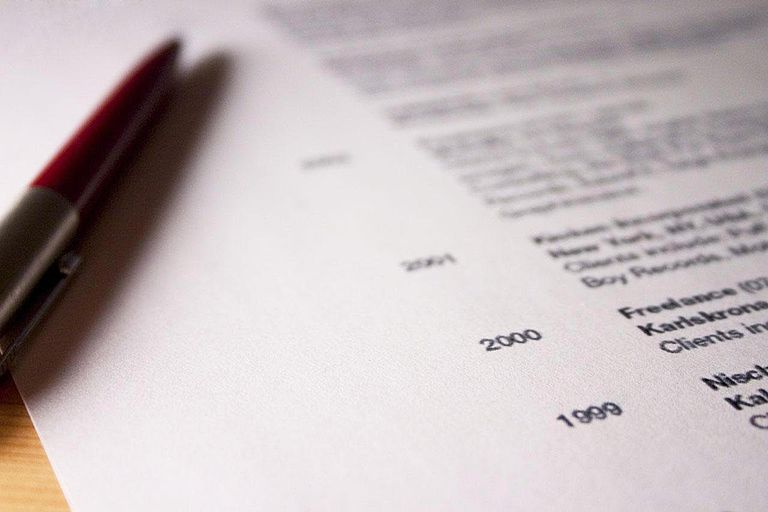 Close-up on a professional resume (curriculum vitae) Some numbers in focus, rest is blurry.