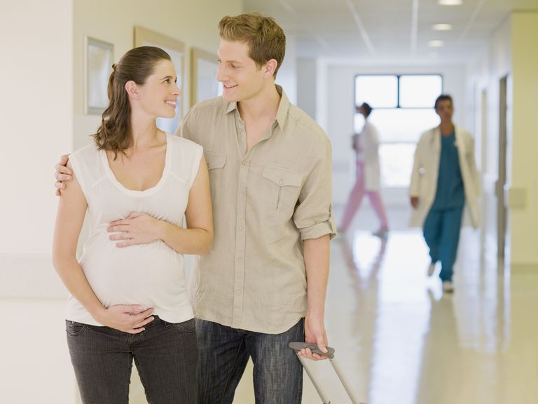 Couple in hospital hall on tour