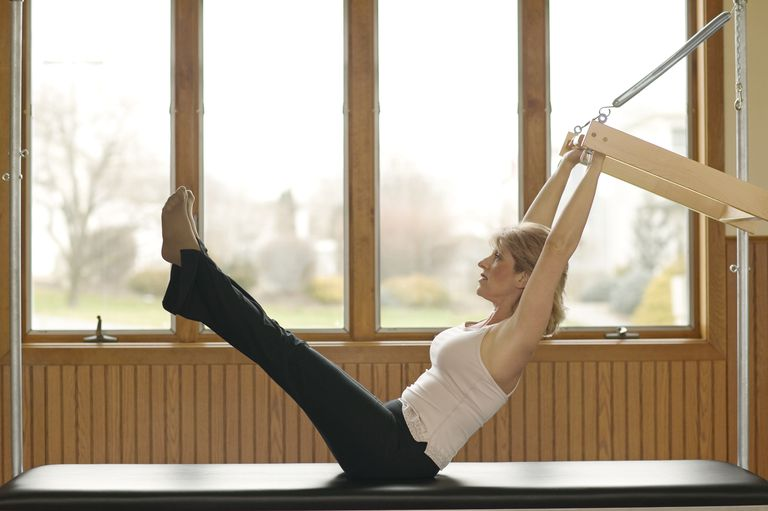 Woman Doing Pilates Exercises