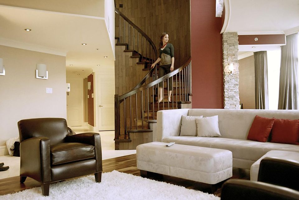 Young woman on staircase in loft apartment