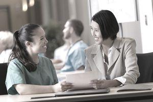 nurse presenting resume at job fair
