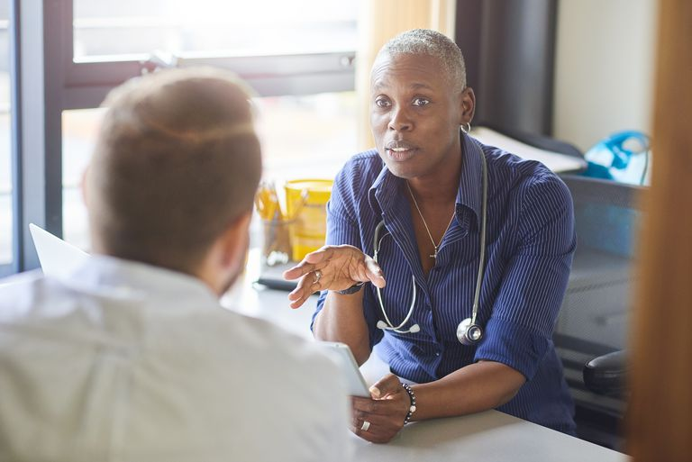 Doctor chatting to male patient