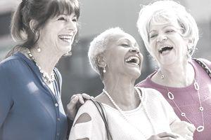 Multi-ethnic older women laughing.