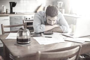 Concerned-looking man going through finances