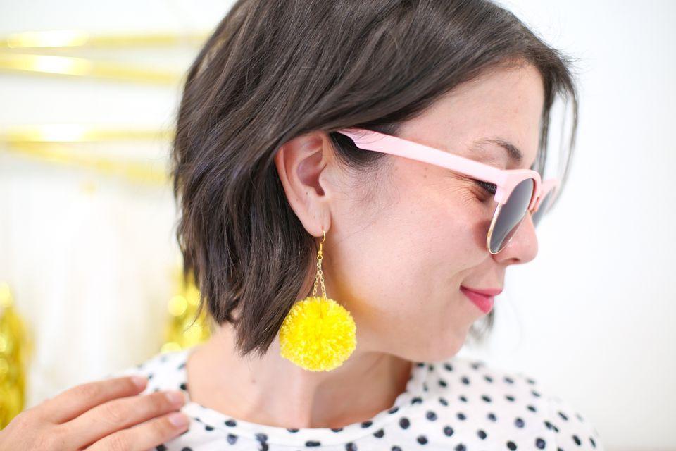 Homemade dangling pom-pom earrings