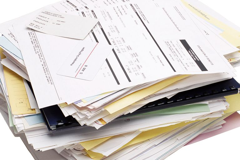 A stack of medical bills and receipts.