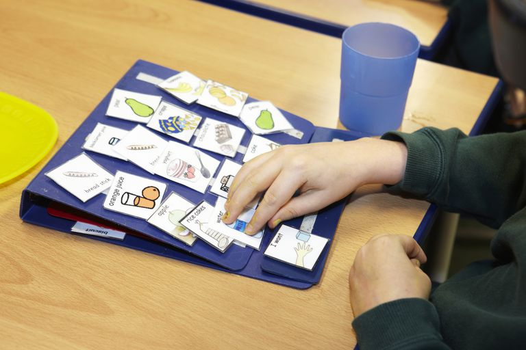 boy using Picture Exchange Cards