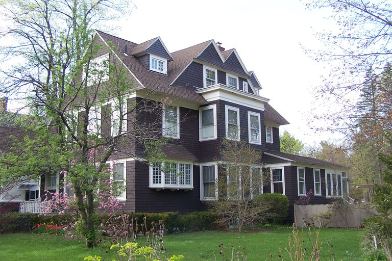 A 19th Century Shingle Style Home Multiple Stories And Windows Dark Brown Shingles With