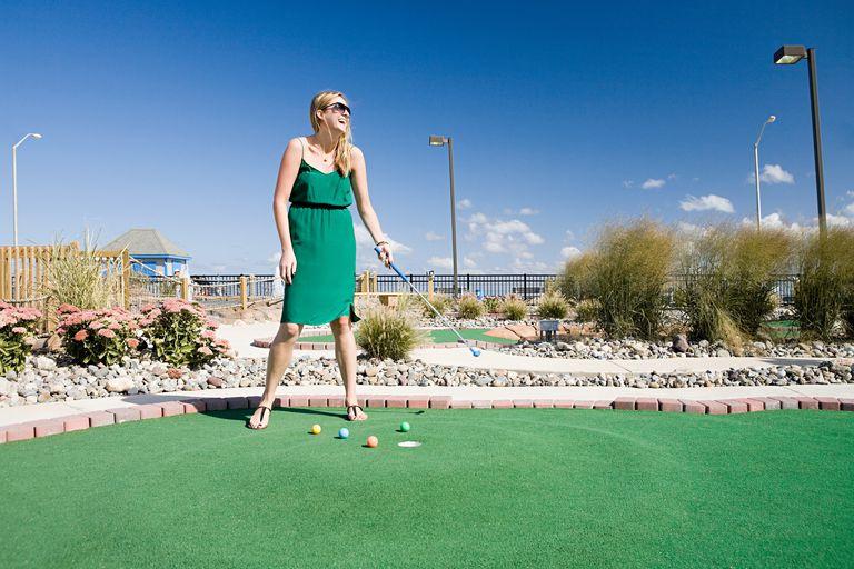 Woman Playing Miniature Golf