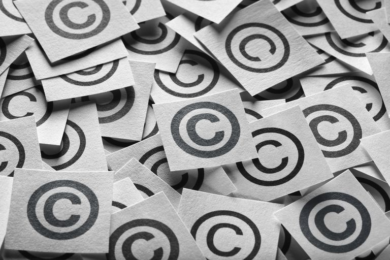 Various copyright sign on a square paper