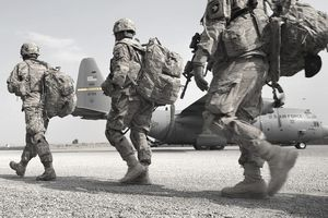 .S. Army soldiers make their way to a C-130 Hercules.