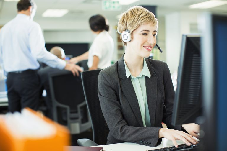 businesswoman talking on headset in office - Samples Of Customer Service Cover Letters