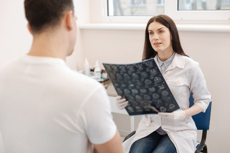 Beautiful pleasant doctor looking at her patient