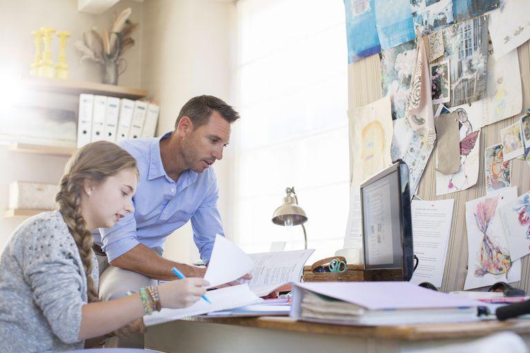 teacher helping teen girl study