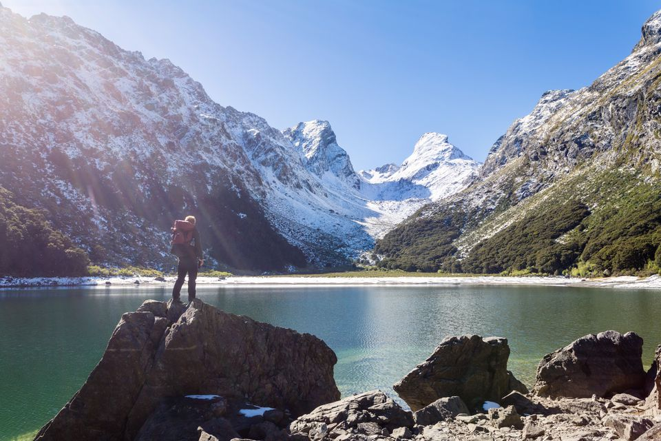 Hiker standind at lake Mackenzie, Routeburn track