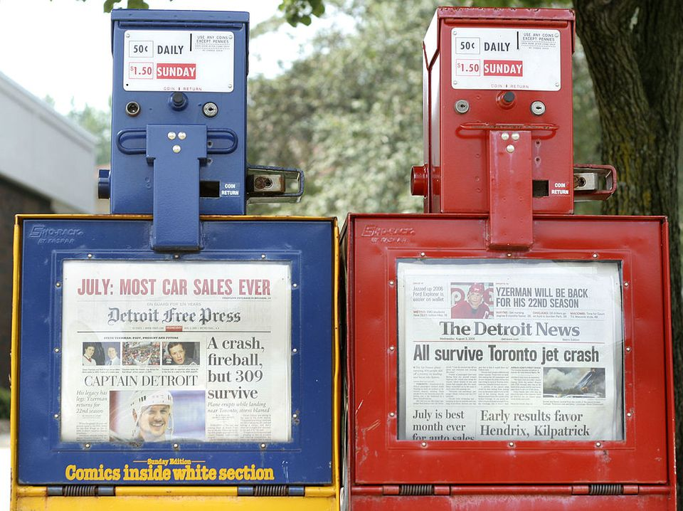 Newspaper boxes selling the competing Detroit Free Press and The Detroit News are shown August 3, 2005 in Detroit, Michigan. In a shuffle of the city's print news outlets, the companies announced today that Knight-Ridder will sell the Free Press to Gannet Co., publisher of 101 daily newspapers in the U.S. At the same time, the News, currently owned by Gannet, will be sold to MediaNews Group Inc.
