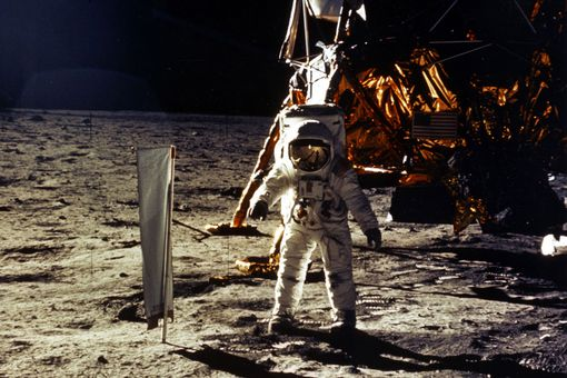 The deployment of scientific experiments by Astronaut Edwin Aldrin Jr. is photographed by Astronaut Neil Armstrong.