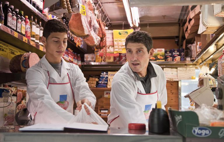 Father and son working at delicatessen together