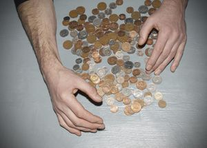 Hands gathering money