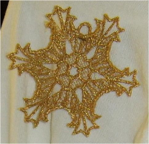 A lace snowflake sewn on a home embroidery machine.