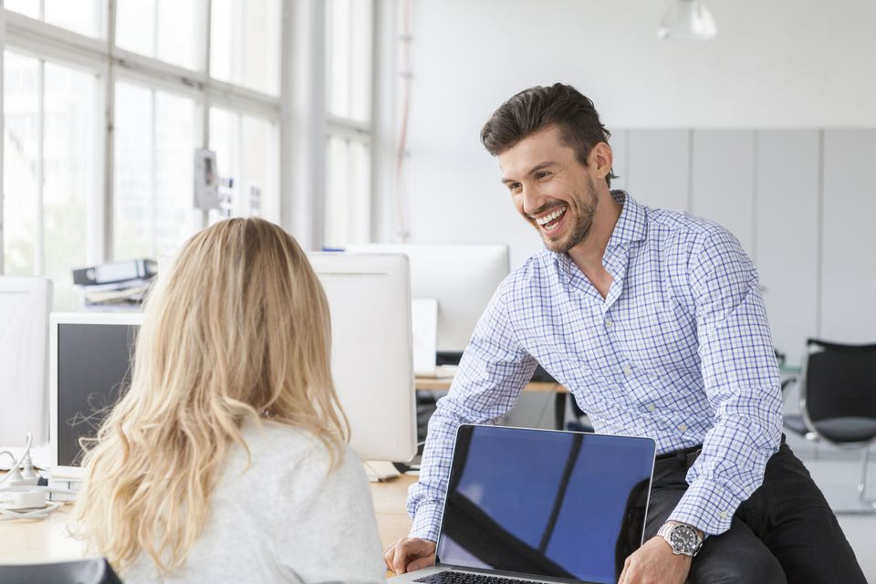 Man flirting with woman at the office