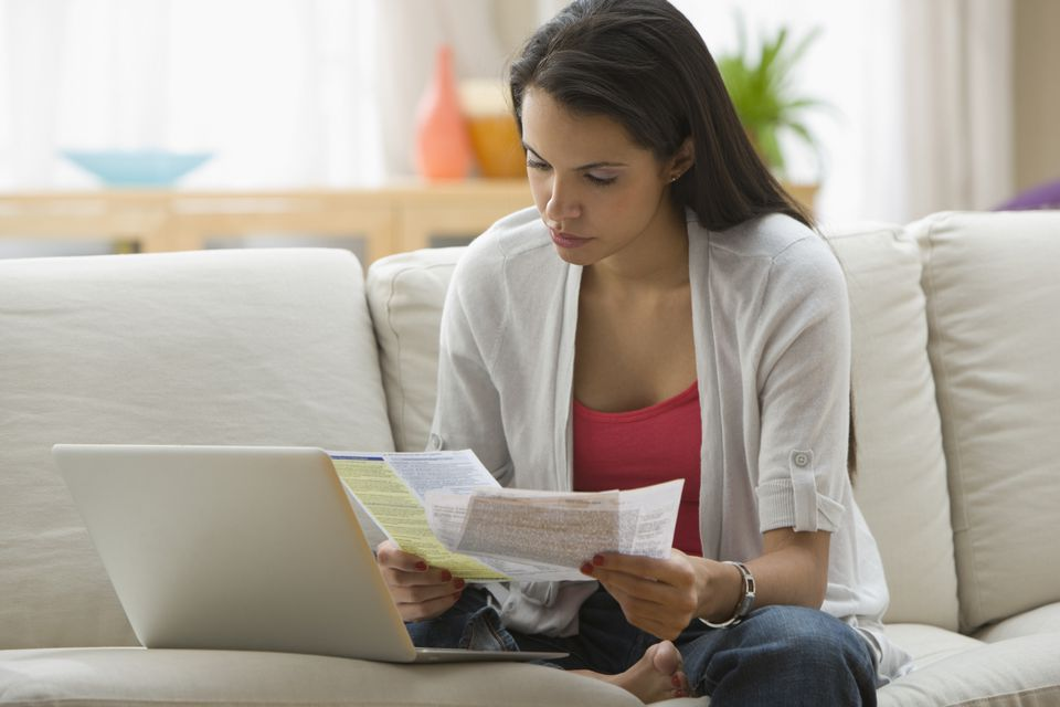 Hispanic woman paying bills online