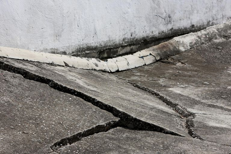 Subsidence underneath a concrete road has caused damage