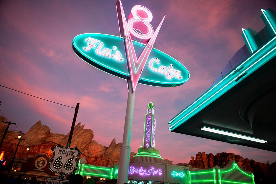A sign for Flo's V8 Cafe' is photographed at dusk in Cars Land in Disney California Adventure Park in Anaheim, July 8, 2012