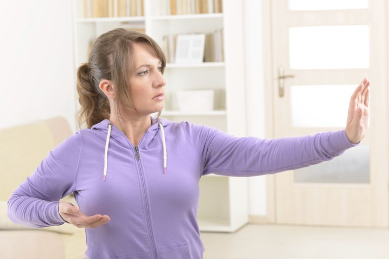 woman in a qigong pose