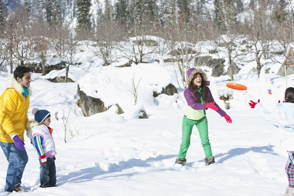 A picture of a family playing snow games