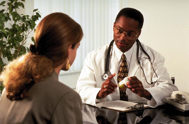 Physician advising a patient about her prescription medication