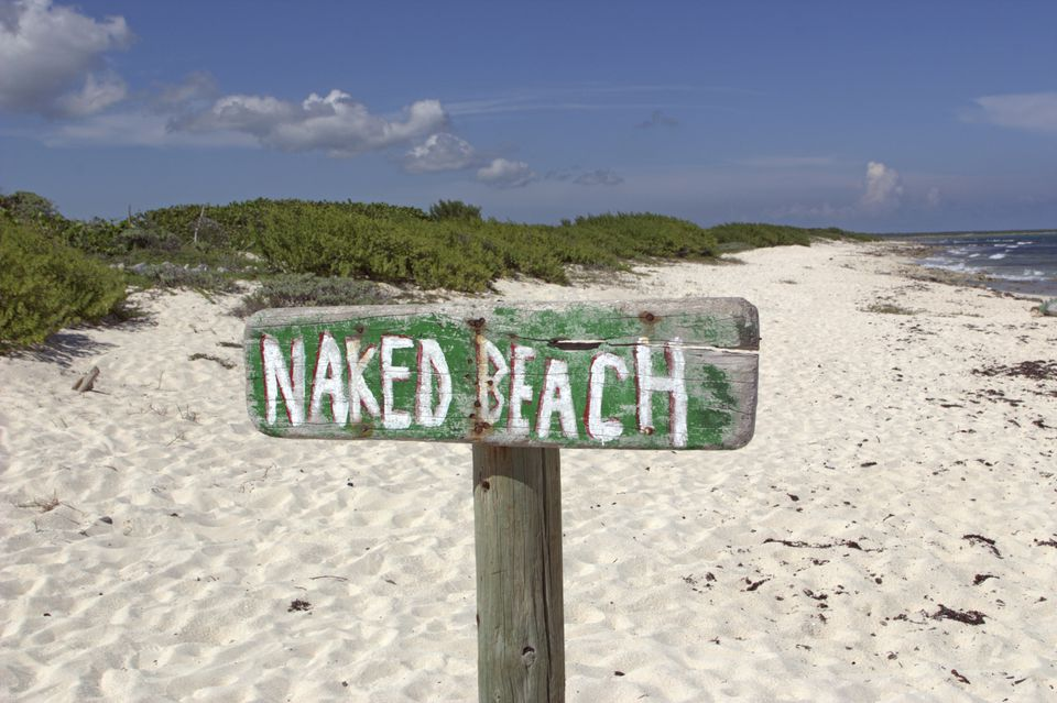 'naked beach' sign