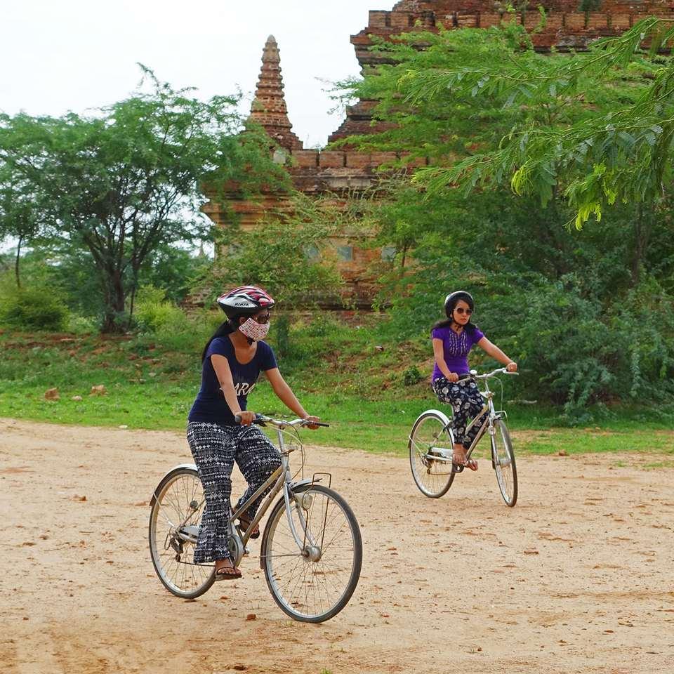 Tourists biking through Bagan, Myanmar