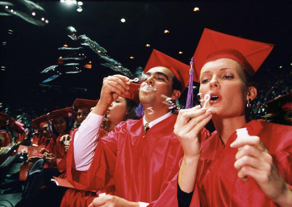 Graduates Blowing Bubbles