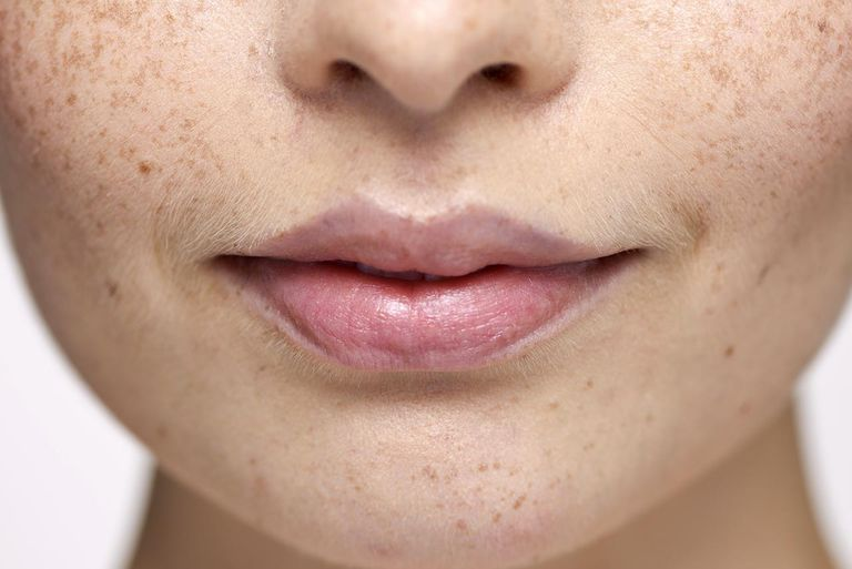 Close-up of young woman's face and lips
