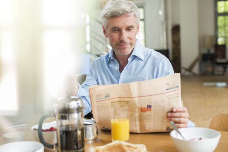 older man having breakfast