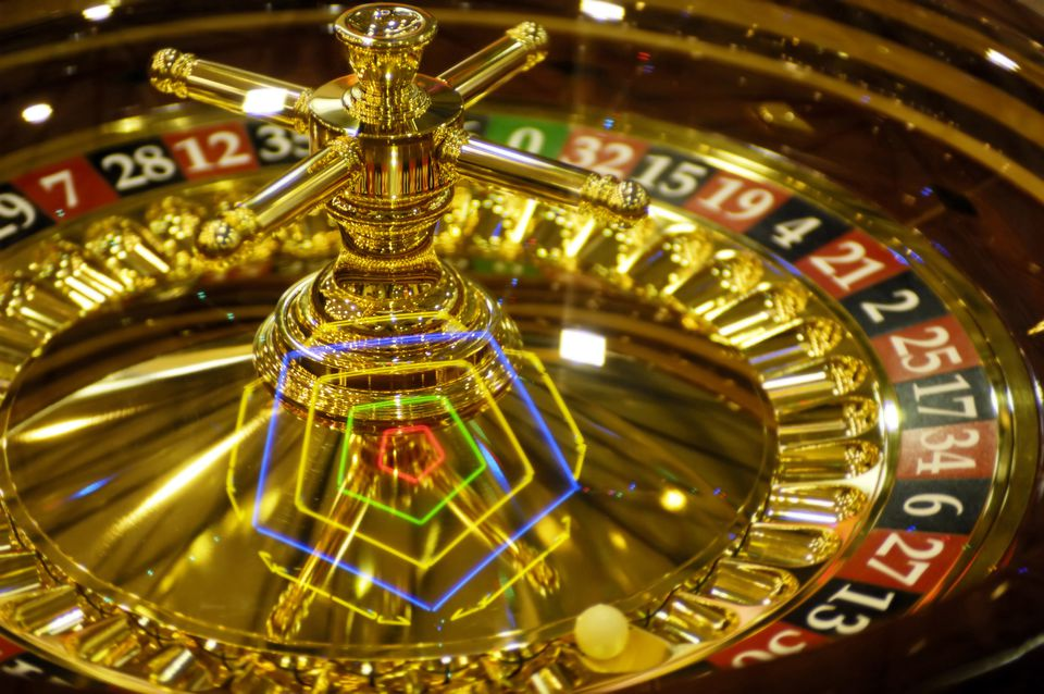 Shining spinning golden casino roulette Gambling and casino equipment conceptual background