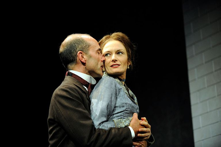 Catherine McCormack (as Nora Helmer) and Finbar Lynch (as Torvald Helmer) perform in Henrik Ibsen's play 'A Doll's House' at the Theatre Royal in Bath.