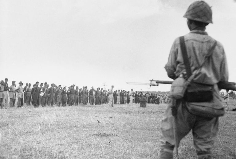 Filipino and American Troops Waiting in Formation