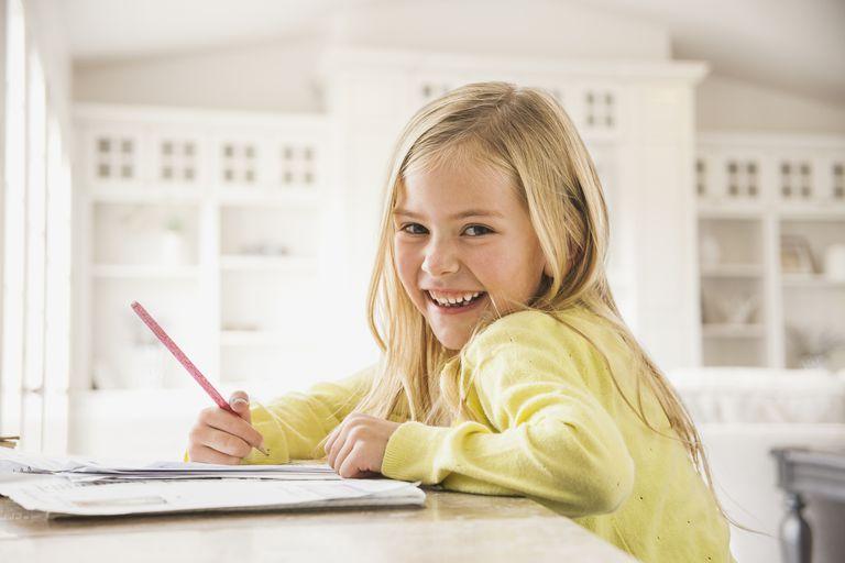 6 year old child development - girl doing homework
