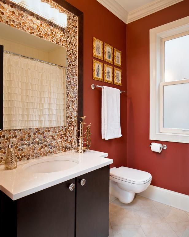 bathroom with a deep red wall