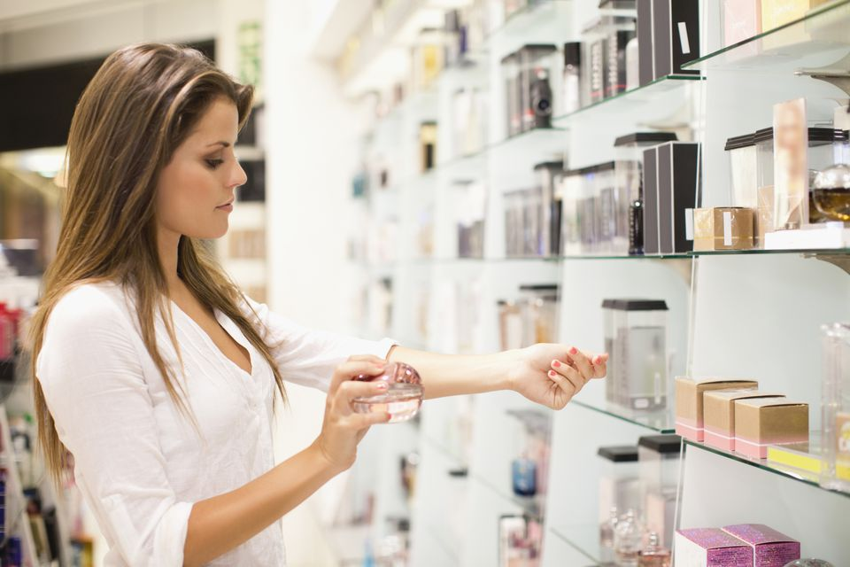 Woman testing fragrance in a store