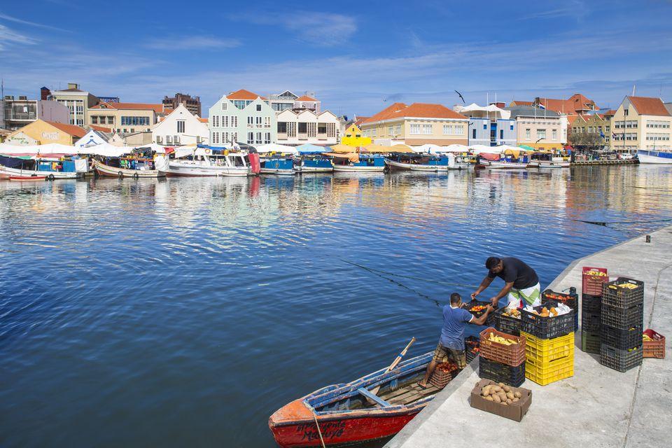 Curacao, Willemstad, Punda, Men loading produce for floating market