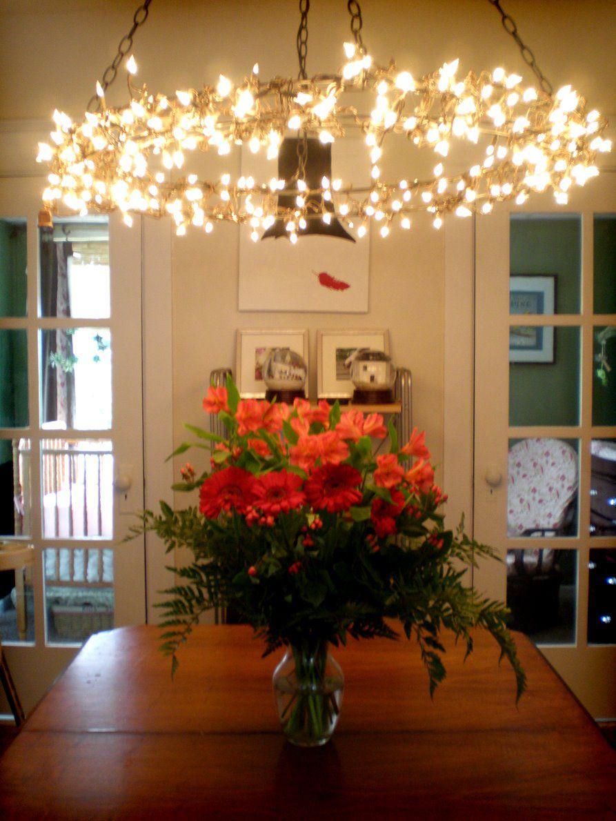 20 ways to decorate for christmas with christmas lights diy christmas lights chandelier aloadofball Choice Image