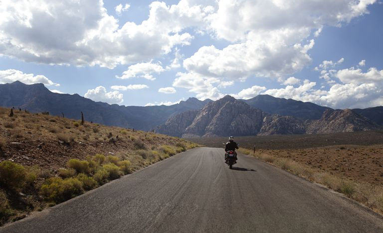 A motorbike rider on an open road